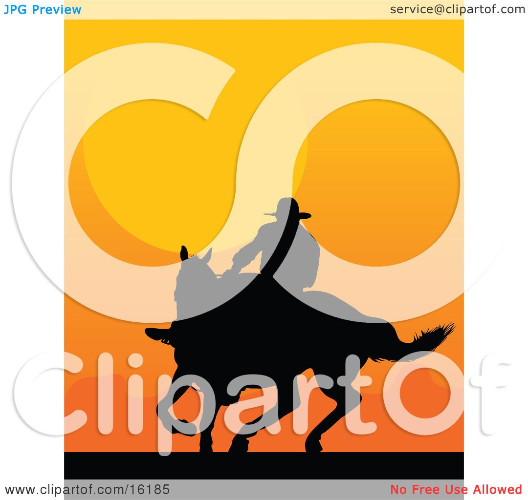 Western Cowboy Riding A Horse And Silhouetted Against An