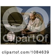 African American Mechanic Working On A Motor Free Stock Photography by JVPD