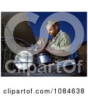 African American Mechanic Working On An Air Filter Free Stock Photography by JVPD