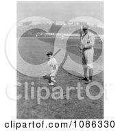 Babe Ruth And A Boy Little Mascot Posing With Bats On A Baseball Field Free Historical Baseball Stock Photography