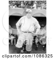 Babe Ruth Standing Near A Dugout Posing In His New York Yankees Uniform Free Historical Baseball Stock Photography by JVPD