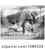 Baseball Umpire Prepared To Make The Call As A Catcher Tags A Runner Free Historical Baseball Stock Photography by JVPD