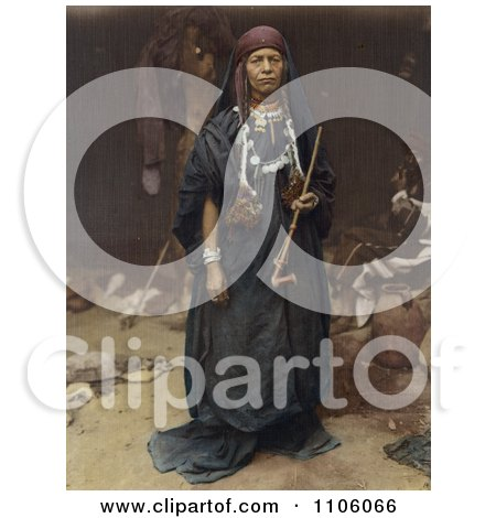 Bedouin Woman Holding A Pipe - Royalty Free Historical Stock Photo by JVPD