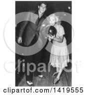 Black And White Historical Stock Photo Of Ronald Reagan And Jane Wyman Holding A Bowling Ball On A Bowling Alley Scene From Brother Rat 1943
