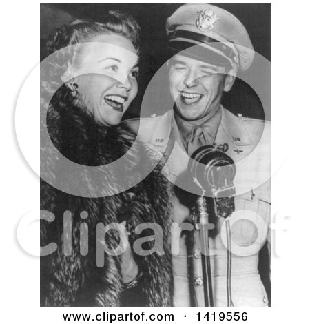 Black and White Historical Stock Photo of Ronald Reagan Standing Beside Jane Wyman at a Microphone, 1943 by JVPD