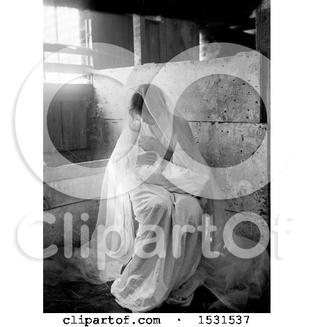 Black and White Photograph of a Young Mother Holding Her Baby in a Manger by JVPD