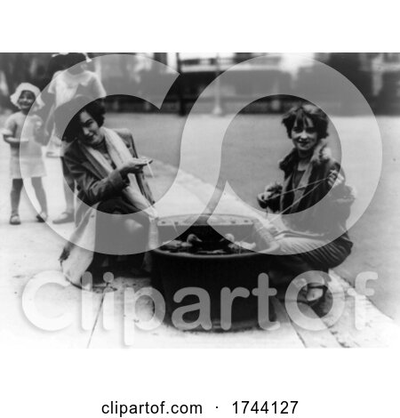 Black and White Photograph of Ladies with Pet Ducks in a Tub on a Sidewalk by JVPD