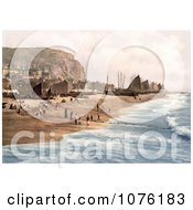 Blue Ocean Waves Rolling Towards Ships Net Shops And People On The Beach At The Fish Market On The East Cliff In Hastings East Sussex England UK Royalty Free Stock Photography