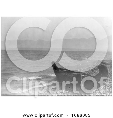 Canoe on Shore at Flathead Lake, Montana - Free Historical Stock Photography by JVPD
