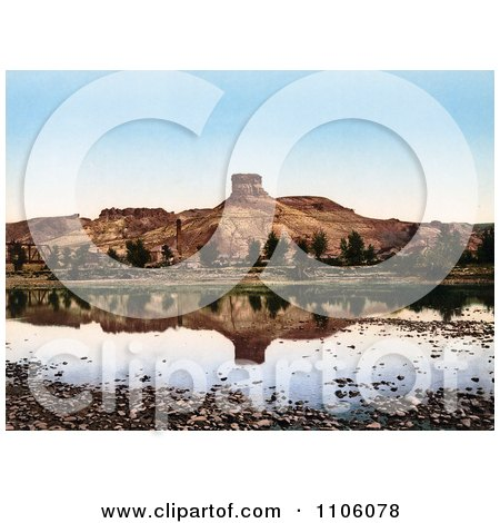 Factory At The Base Of A Butte Reflecting In Green River, Utah - Royalty Free Historical Stock Photo by JVPD