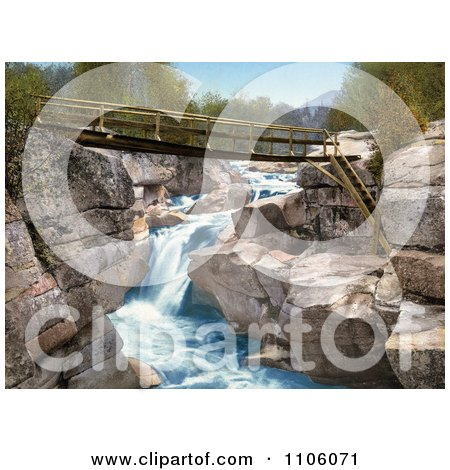 Footbridge Over The Upper Falls Of The Ammonoosuc River In The White Mountains Of New Hampsire - Royalty Free Historical Stock Photo by JVPD