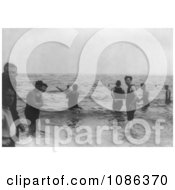 Group Of Men Wading In Waist Deep Water And Playing Baseball In The Water Free Historical Baseball Stock Photography by JVPD