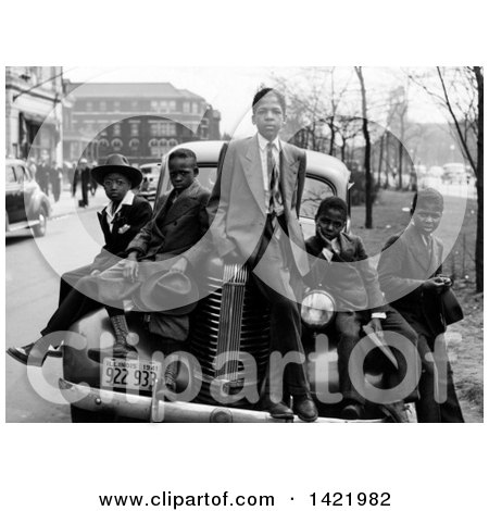 Historical Black and White Stock Photo of 5 African American boys dressed in suits, posing on and around a car, Southside, Chicago, Illinois, April 1941 by JVPD