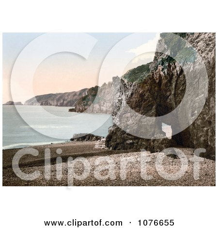 Historical Cave Through the Rocks on the Beach of Dixcart Bay in Sark, England - Royalty Free Stock Photography  by JVPD