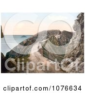 Historical Man Leaning Against The Railing On La Coupee Isthmus In Sark England Royalty Free Stock Photography