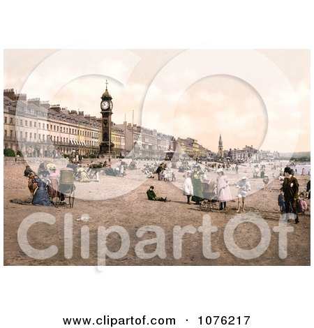 Historical People Enjoying the Beach by the Jubilee Clock Tower in Weymouth Dorset England UK - Royalty Free Stock Photography  by JVPD