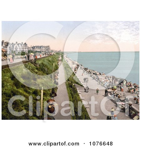 Historical People Strolling on the Promenade at Clacton-on-Sea, Essex, England - Royalty Free Stock Photography  by JVPD