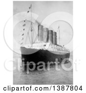 Historical Photograph Of The Bow And Portside Of The RMS Lusitania In A Harbor Many Different Flags Along A Rope Between 1908 And 1914