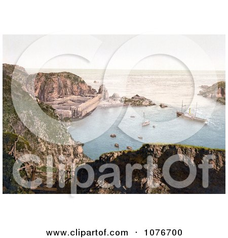Historical Ships Down Below in the Creux Harbor in Sark, Channel Islands, England - Royalty Free Stock Photography  by JVPD