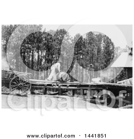 Historical Stock Photo of a Man Working at a Turpentine Still by JVPD