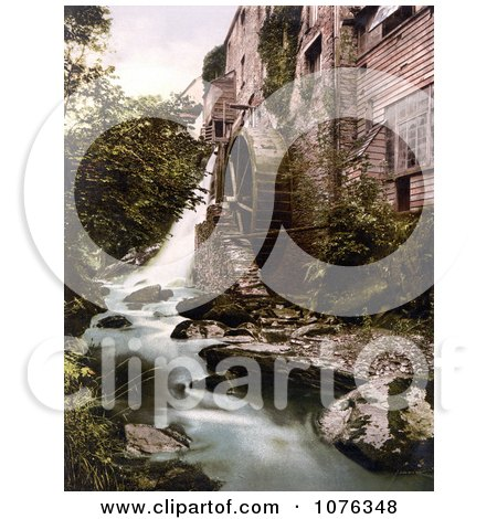 Historical the Wheel at the Lyn Bridge Mill on the East Lyn River in Lynton and Lynmouth Devon England - Royalty Free Stock Photography  by JVPD