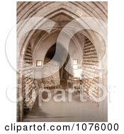 Human Skulls And Skeletal Remains Stacked In The Ossuary Bone Store Of The Church Crypt In Hythe Kent England Royalty Free Stock Photography by JVPD