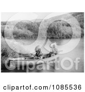 Lakota Indians In A Canoe Free Historical Stock Photography by JVPD