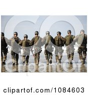 Line Of Soldiers Walking Away Towards The Surf On A Beach Free Stock Photography