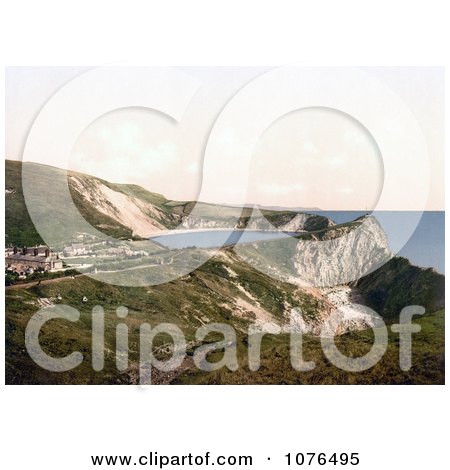 Lulworth Cove on the Coast in Lulworth Dorset England - Royalty Free Stock Photography  by JVPD