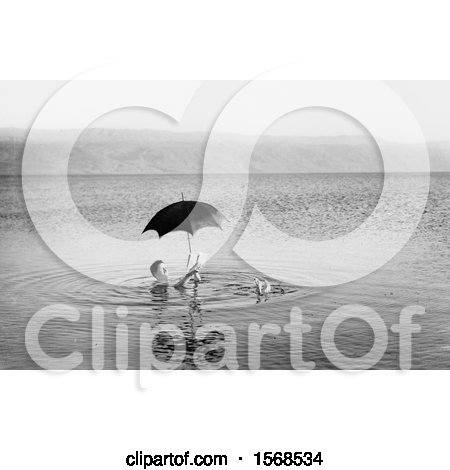 Man Floating with Umbrella and Book in the Dead Sea by JVPD