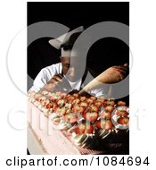 Man Frosting Cakes Free Stock Photography by JVPD