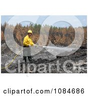 Man Putting Out A Fire Free Stock Photography by JVPD