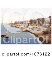 Man Rowing A Boat Near A Beach With Boats Lined Up On The Shore And Waterfront Buildings In Herne Bay Kent South East England Royalty Free Stock Photography