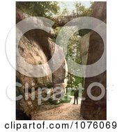 Man Standing Under A Footbridge Between Rocks At The High Rocks In Tunbridge Wells Kent England UK Royalty Free Stock Photography