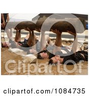 Men Lifting A Wooden Log Free Stock Photography