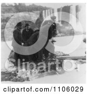 Men Pulling Annie E TaylorS Barrel Out Of The Water At Niagara Royalty Free Historical Stock Photography by JVPD
