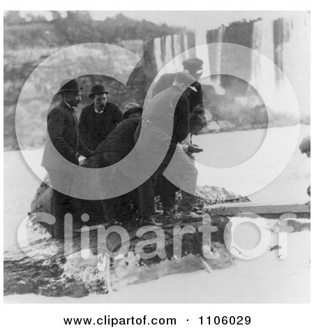 Men Pulling Annie E Taylor's Barrel Out of the Water at Niagara - Royalty Free Historical Stock Photography by JVPD