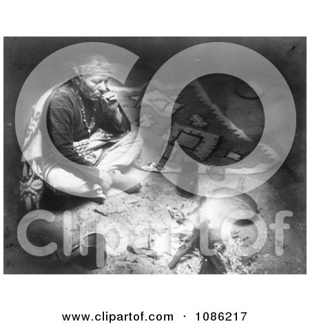 Navajo Indian Smoking by Fire - Free Historical Stock Photography by JVPD