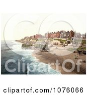 People Near Boats And Bathing Machines On The Beach In Southwell England Royalty Free Stock Photography