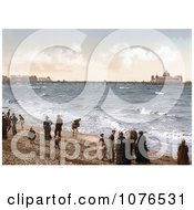 People On The Beach Playing In The Surf Near The Pier In Morecambe Lancashire England UK Royalty Free Stock Photography