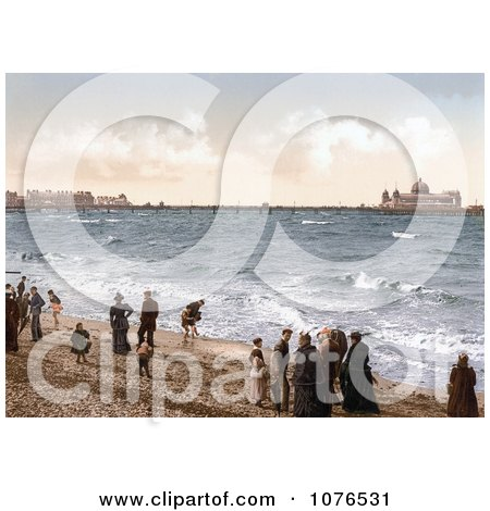 People on the Beach Playing in the Surf Near the Pier in Morecambe Lancashire England UK - Royalty Free Stock Photography  by JVPD