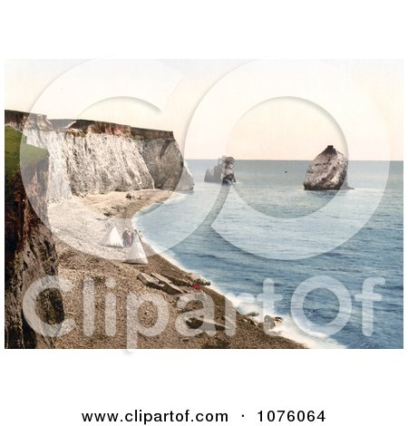 People on the Beach With Tents on the Isle of Wight England - Royalty Free Stock Photography  by JVPD