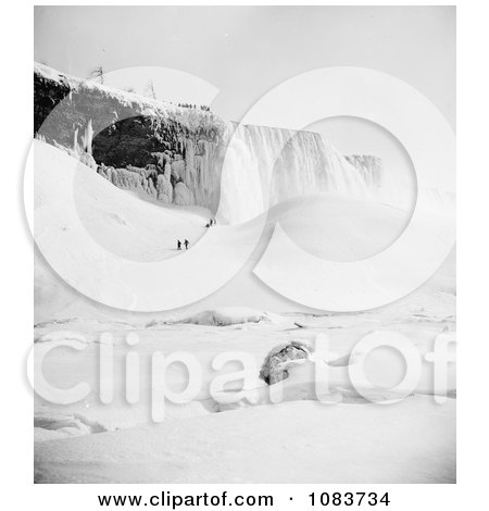 People Walking Through The Snow Towards An Icy Mountain At Niagara Falls In Winter - Royalty Free Historical Stock Photography by JVPD