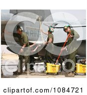 People Washing Military Aircraft Free Stock Photography by JVPD