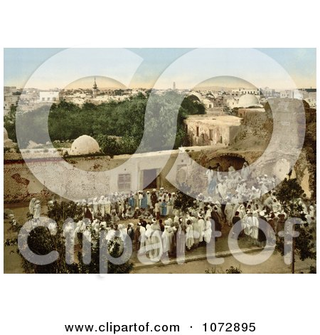 Photochrom of a Crowd Watching a Snake Charmer in Tunis, Tunisia - Royalty Free Historical Stock Photography by JVPD