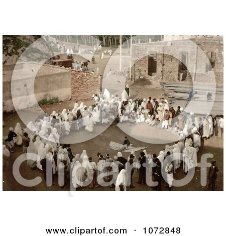 Photochrom of a Group of Spectators Circled Around an Arab Juggler, Algeria - Royalty Free Historical Stock Photography by JVPD