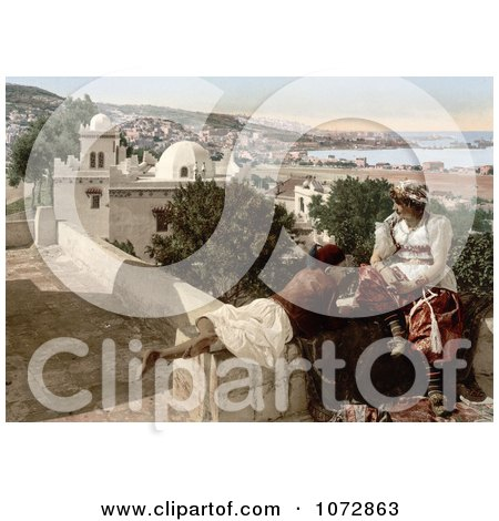Photochrom of a Moorish Child and Woman on a Terrace, Algeria - Royalty Free Historical Stock Photography by JVPD