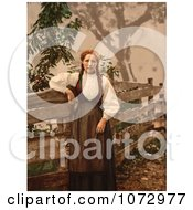 Photochrom Of A Norwegian Woman By A Fence Royalty Free Historical Stock Photography
