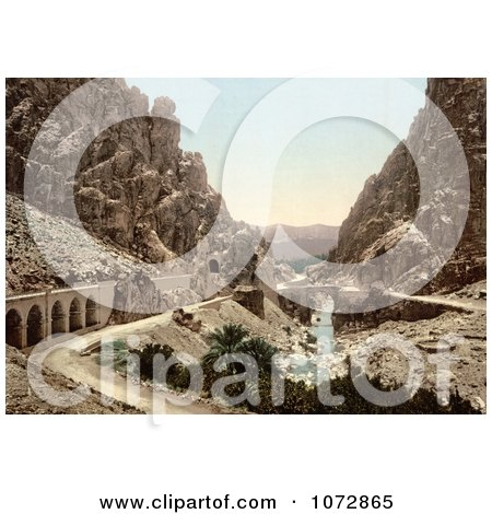 Photochrom of a Road, Bridge and Stream in a Ravine, El Cantara, Algeria - Royalty Free Historical Stock Photography by JVPD