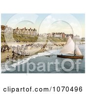 Photochrom Of People Crowding On The Beach As A Yacht Starts Off From Clacton On Sea Essex England Royalty Free Historical Stock Photography by JVPD
